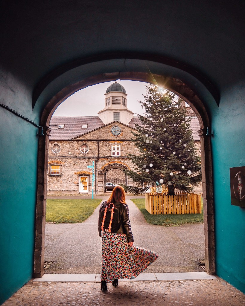 Girl standing in front of Christmas Tree with a Gaston Luga backpack in Kilkenny Ireland