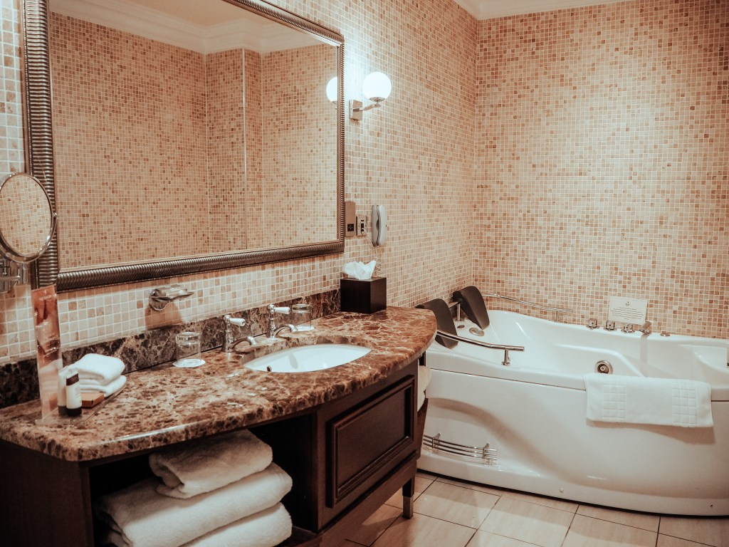 Luxurious bathroom at The Dovecote suite in Lough Erne hotel with a double jacuzzi in the corner.