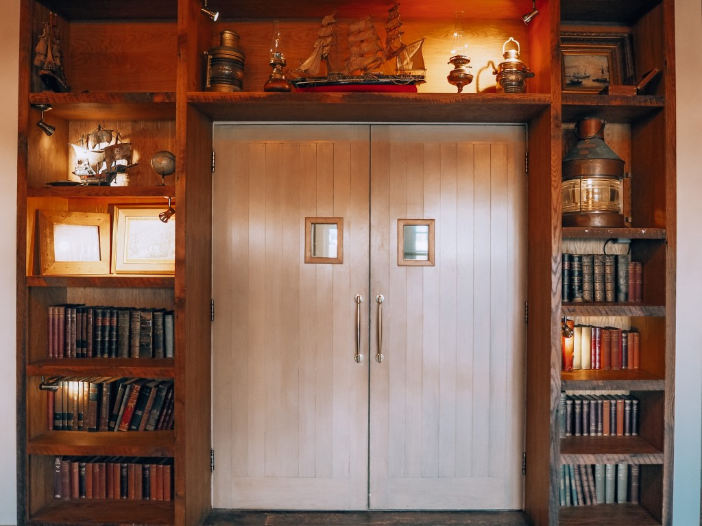 Doorway surrounded by shelving containing books