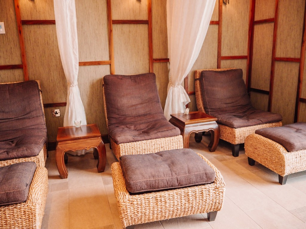 Relaxation area of the Thai Spa in one of Ireland's most luxurious hotels Lough Erne. Relaxation chairs with foot stools with each area separated by a net curtain.