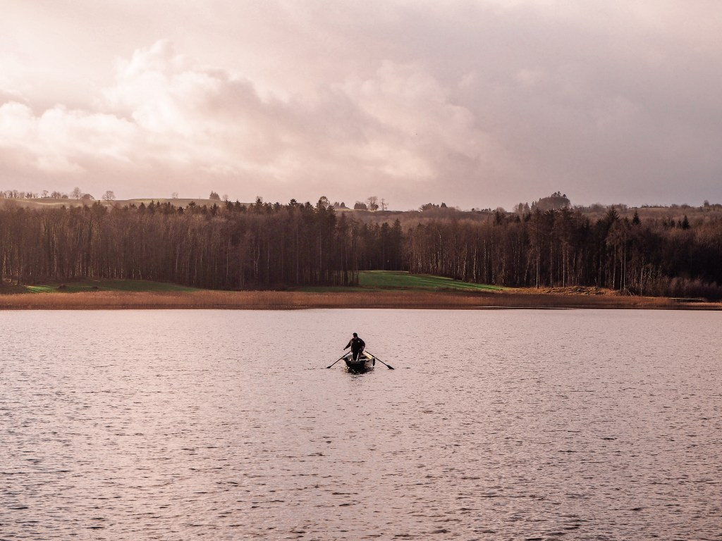Fisherman in a rowing boat on Lough Erne