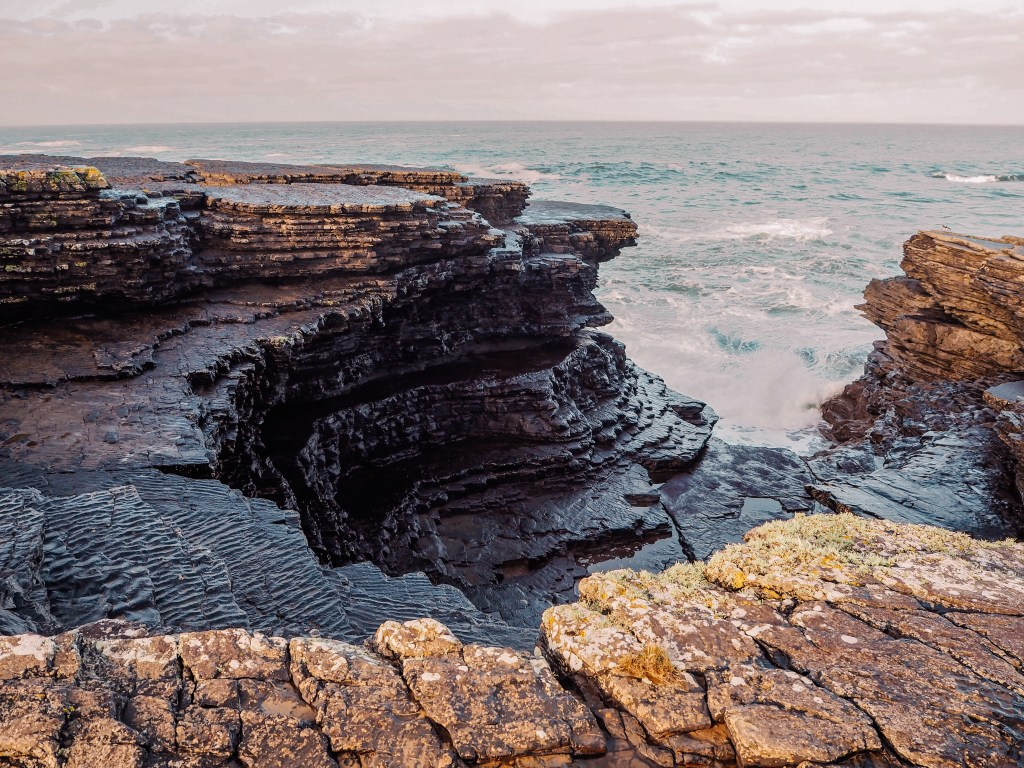 Unusual rock formations at Kilkee Cliffs in Ireland
