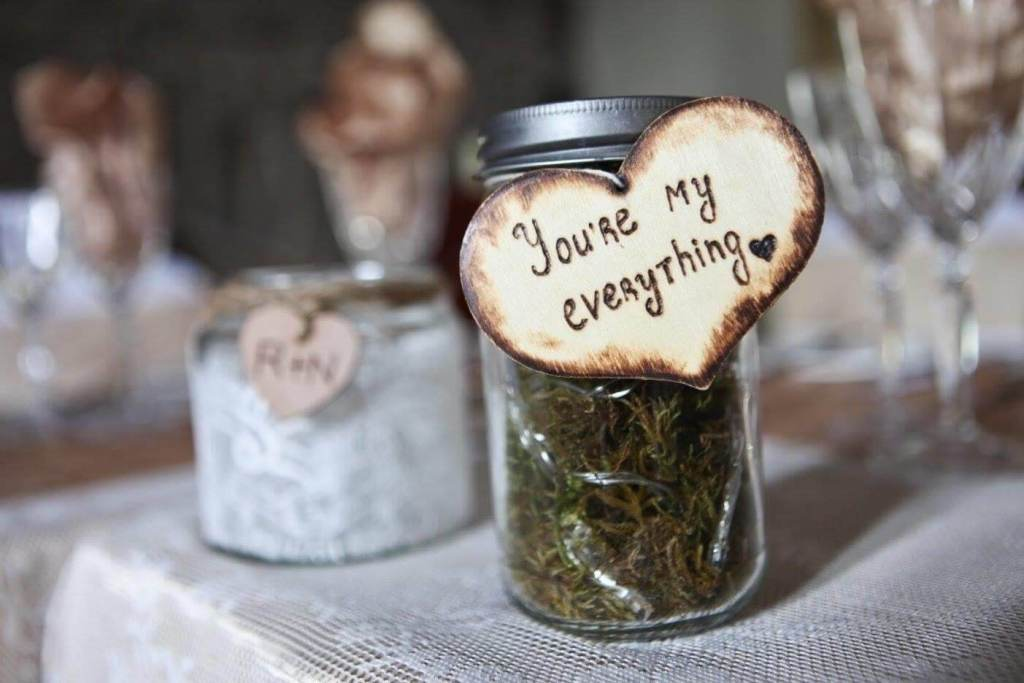 Picture of a Mason Jar at a wedding with the words you are my everything