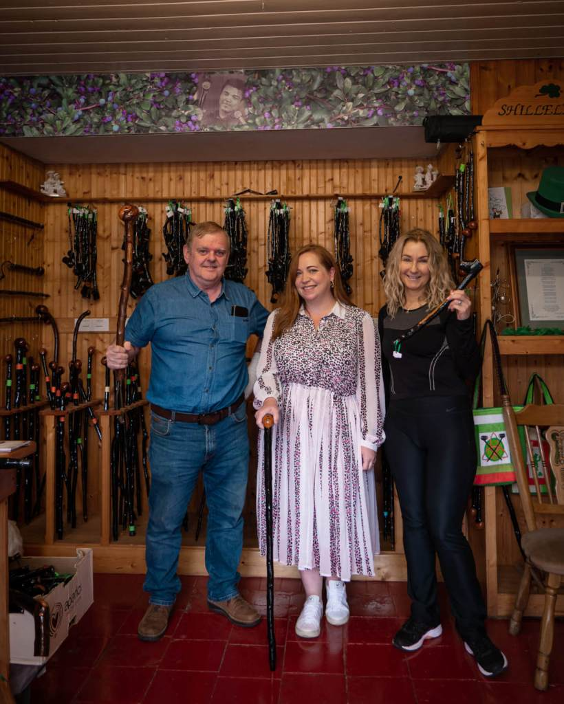 Woman meeting the owners of the Olde Shillelagh Stick Maker Shop in Wicklow Ireland