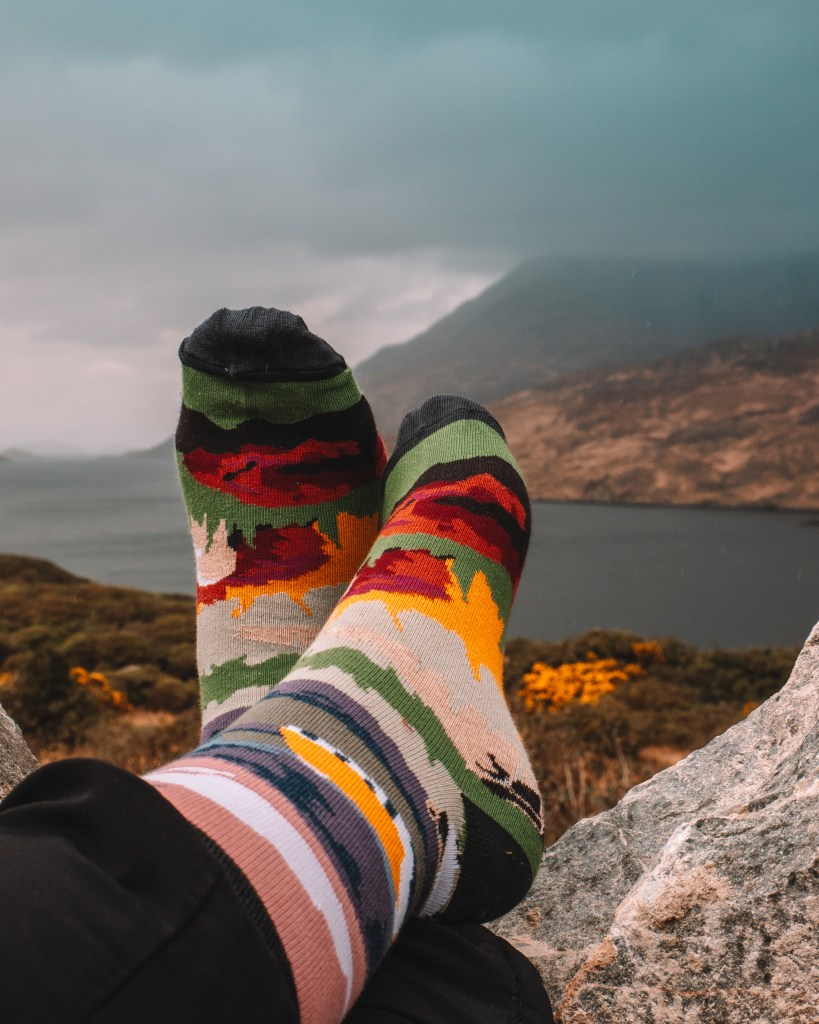 Image of Connemara socks with a backdrop view of Connemara Ireland
