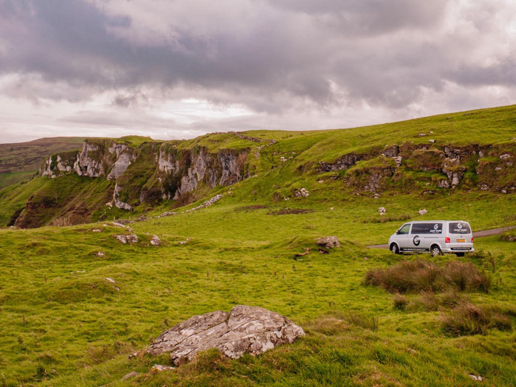Giant Tours game of thrones van parked up against the dramatic cliffs at Murlough Bay