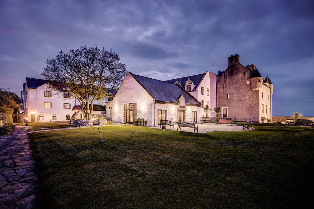 Exterior and gardens of Ballygally Castle Hotel Northern Ireland
