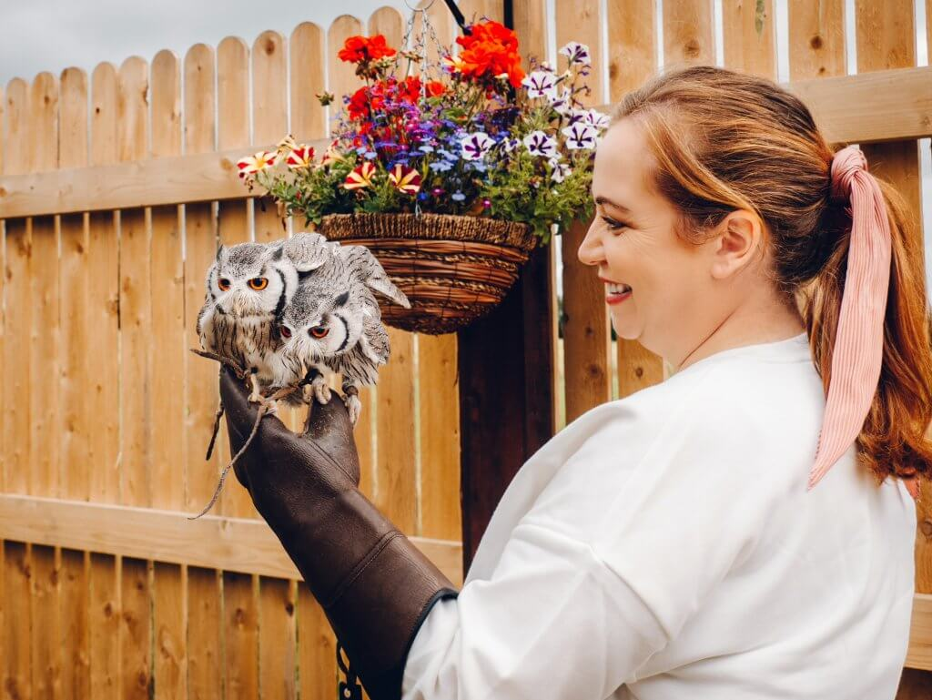 Woman getting an owl selfie with Turbo and Diesel two South African white faced owls at the hawkeye school of falconry