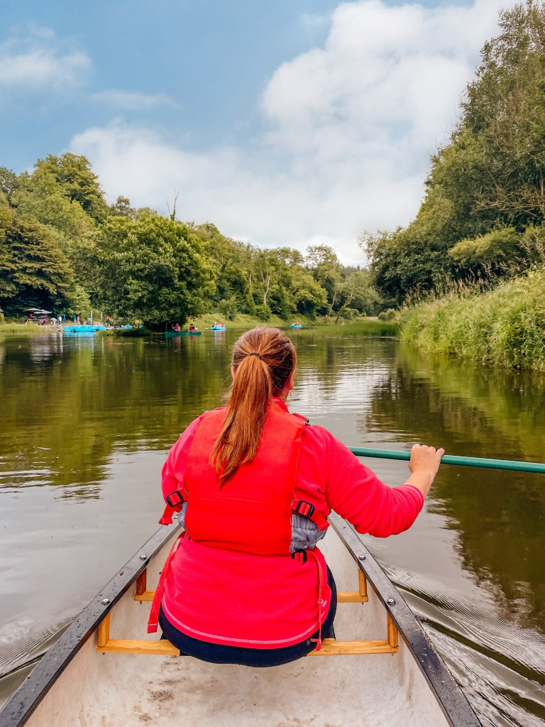 Woman canoeing in the lake at Castlecomer Discovery Park Kilkenny Ireland