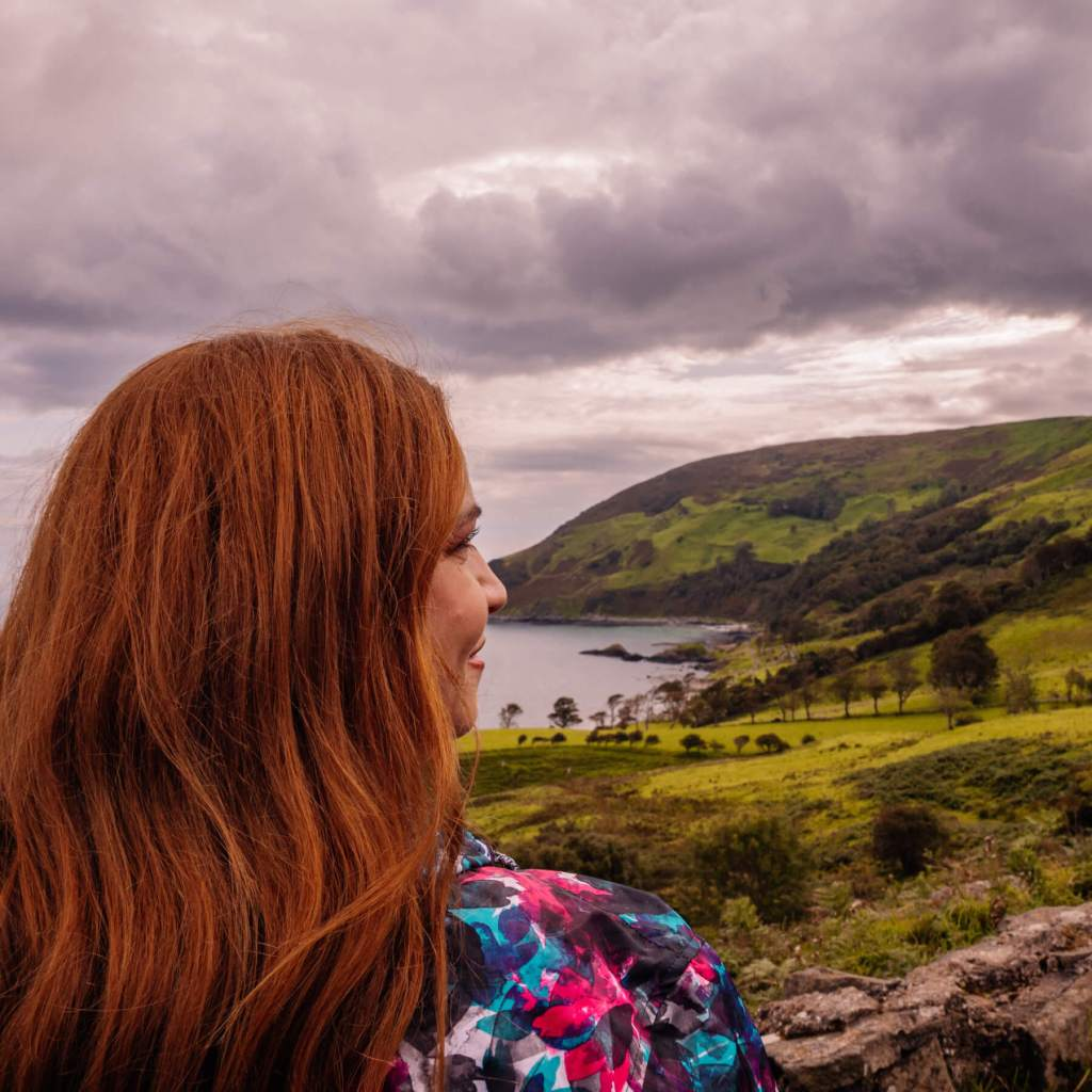Over the shoulder shot of Murlough Bay in County Antrim Northern Ireland