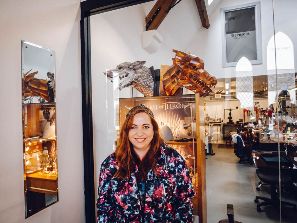 Woman with red hair wearing Sansa Stark's crown on a game of thrones Ireland tour