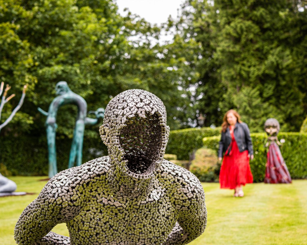 Woman exploring the art and soul international art fair at Culloden Estate and Spa