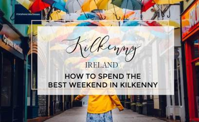 Woman walking under an umbrella sky with text overlay how to spend the best weekend in Kilkenny Ireland