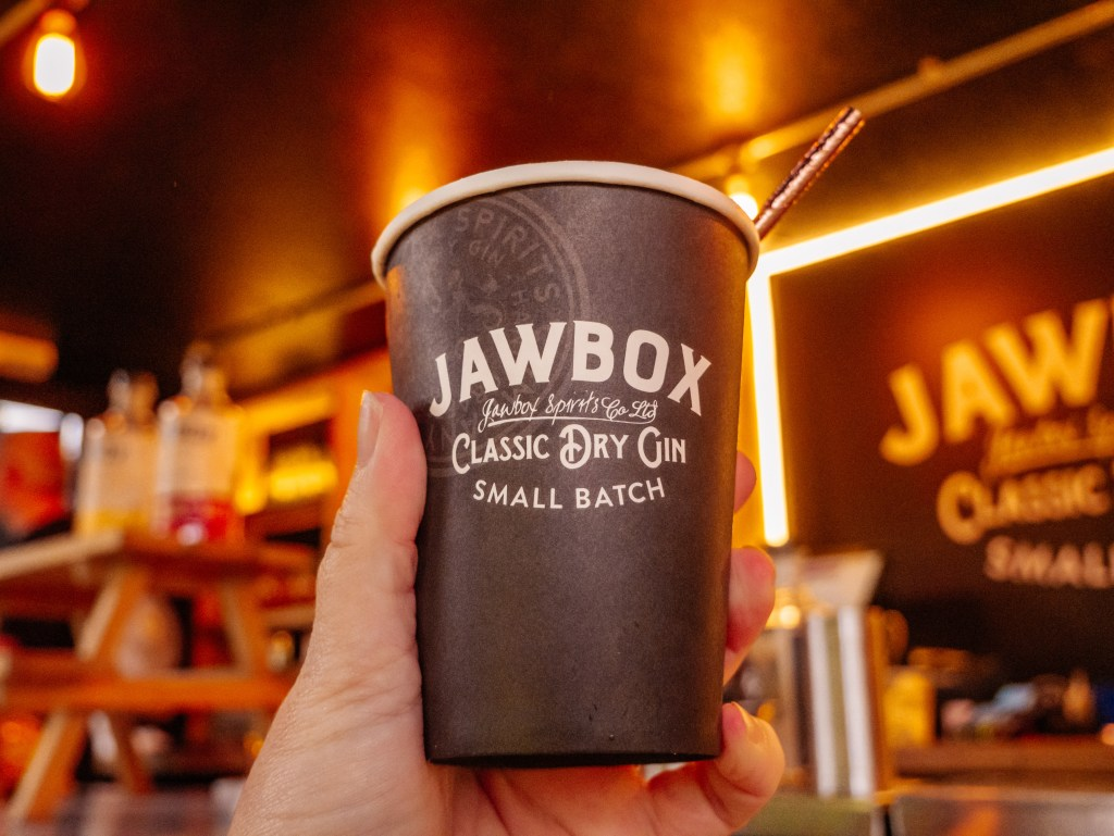 Woman holding a cup of Jawbox Gin