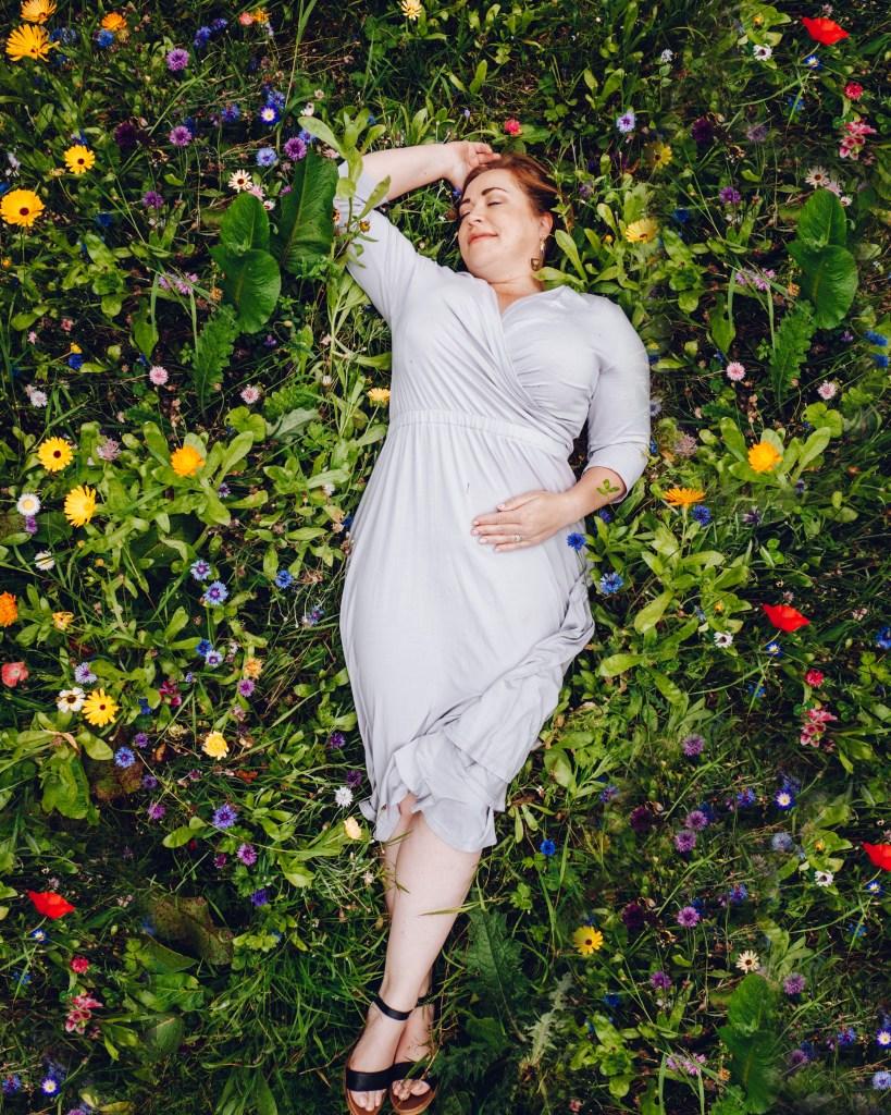 Woman lying in a wildflower garden at Glenarm Castle in Antrim