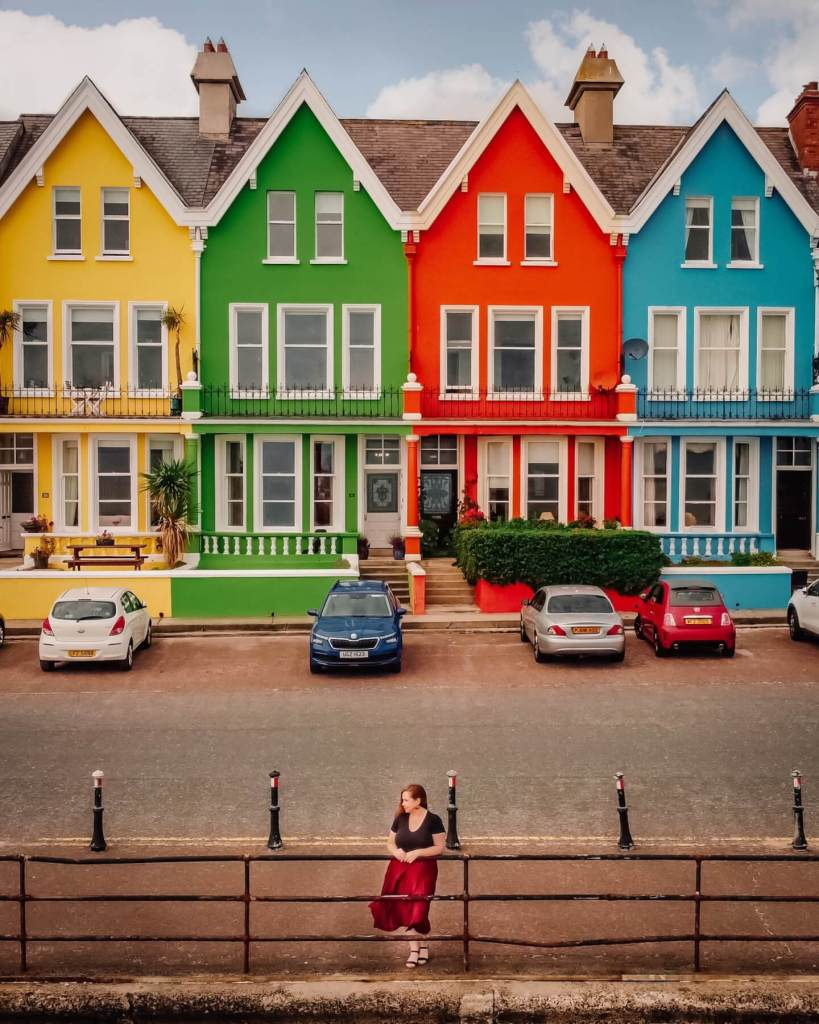 Row of colourful houses in Whitehead along the Antrim Coastal Route, a hidden gem in Antrim Northern Ireland