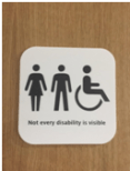 """A photo depicting the symbol for an accessible restroom that reads """"Not every disability is visible."""""""
