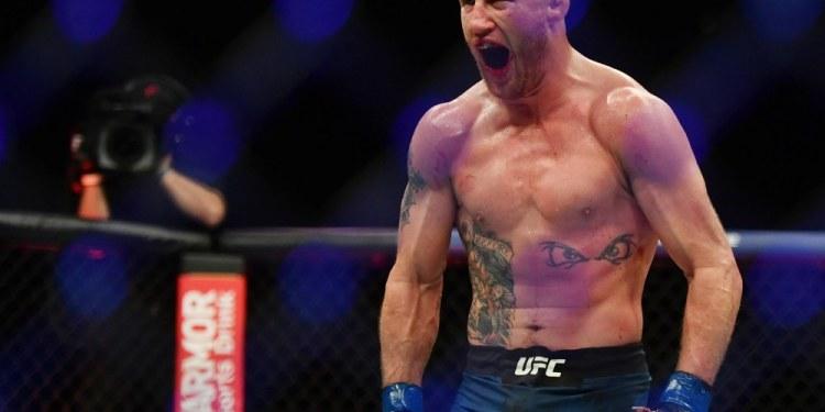 May 9, 2020; Jacksonville, Florida, USA; Justin Gaethje (blue gloves) celebrates after defeating Tony Ferguson (red gloves) during UFC 249 at VyStar Veterans Memorial Arena. Mandatory Credit: Jasen Vinlove-USA TODAY Sports