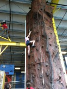 TweedleDee climbing the rock wall at Carnegie Science Center.