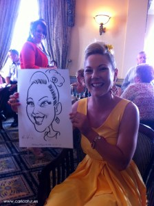 Woman in yellow dress holding caricature by caricature artist Allan Cavanagh