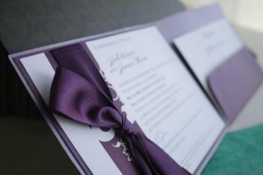 Purple pocket invitation with ribbon finish