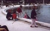 Children sail boats in a Tuileries pond. (Allan Lynch Photo)