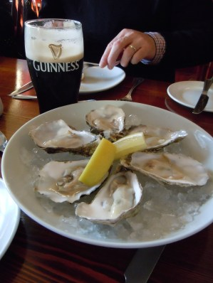 Guinness and local oysters in Kinsale. (Allan Lynch Photo)