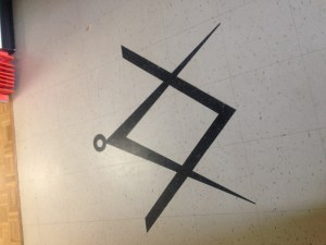 Masonic Symbol of the floor of the Lodge that hosted the event.