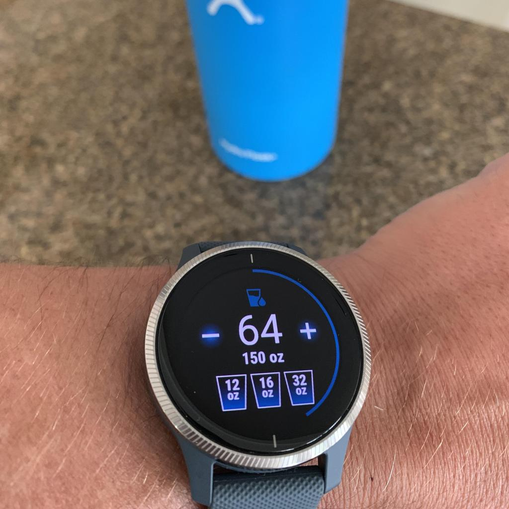 Garmin Venu water tracking app with water bottle in the background