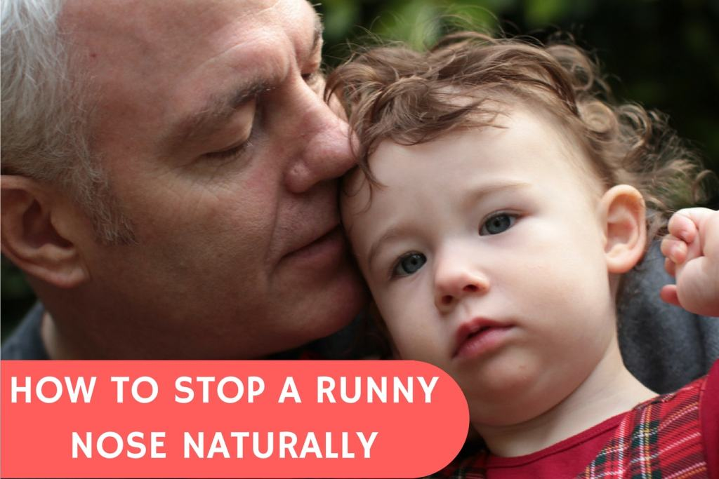 man used natural remedies to cure grandson's runny nose. They are happy outside together.