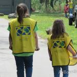 "2 little girls head toward the ""Mormon Helping Hands"" project"