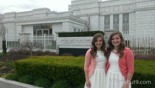 Emily and Anna pose outside the Detroit temple during a visit to  their Grandpa and Grandma C's.