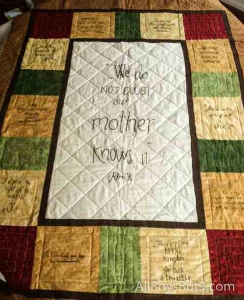 a quilt handmade by our 9 daughters (our son contributed his scripture from Argentina)