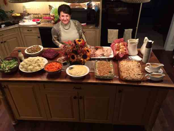 CaMarie in front of our Thanksgiving Feast