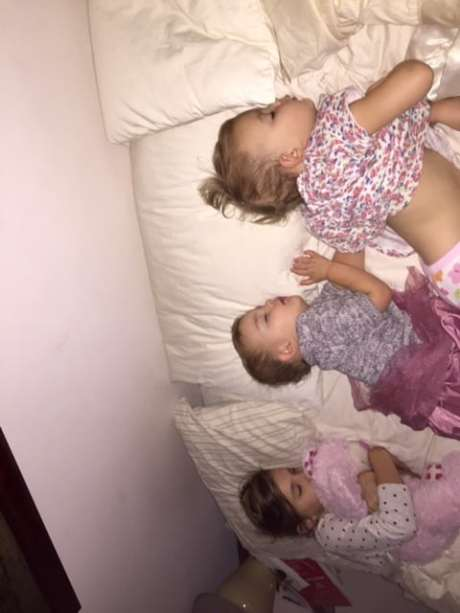 clara, addie, and sarah in bed