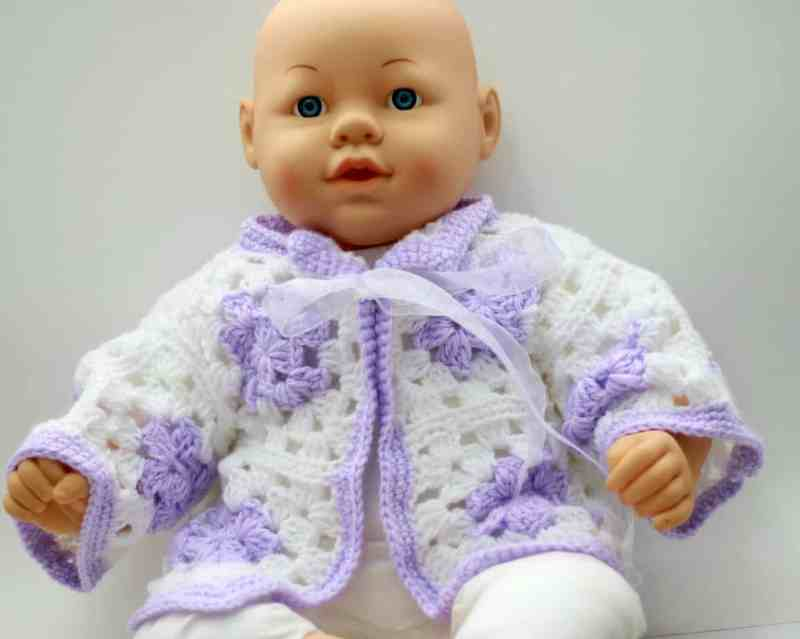 doll wearing sweater)