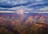 An autumn thunderstorm passes over the grandiosity of the Grand Canyon