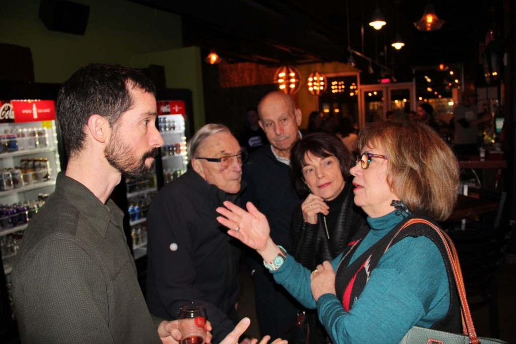 Filmmaker Mark Dixon talks with supporters at his sendoff party in November. Photo: Reid Frazier