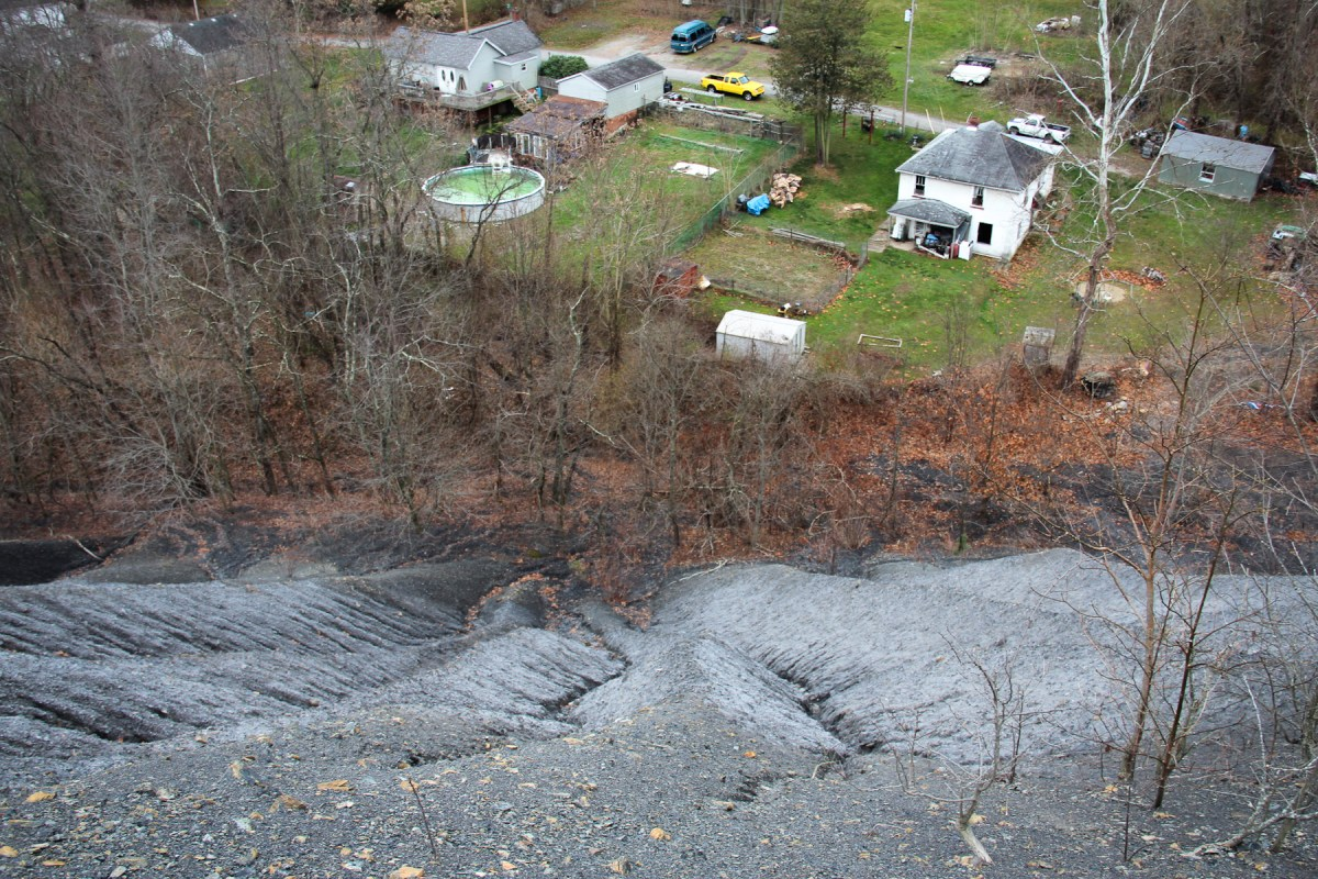 An enormous coal refuse pile hovers over the town of Fredericktown in southwestern Pennsylvania. Decades ago, companies just left piles like these behind when a mine stopped making money. Because of this, Pennsylvania has been left with hundreds of these sites—the most of any state in the country. Photo: Reid Frazier