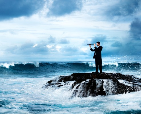 conceptual image of man looking through telescope surrounded by water.