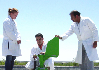 Dr. Ghosh (far right) and students inspect the Burkard Volumetric ...