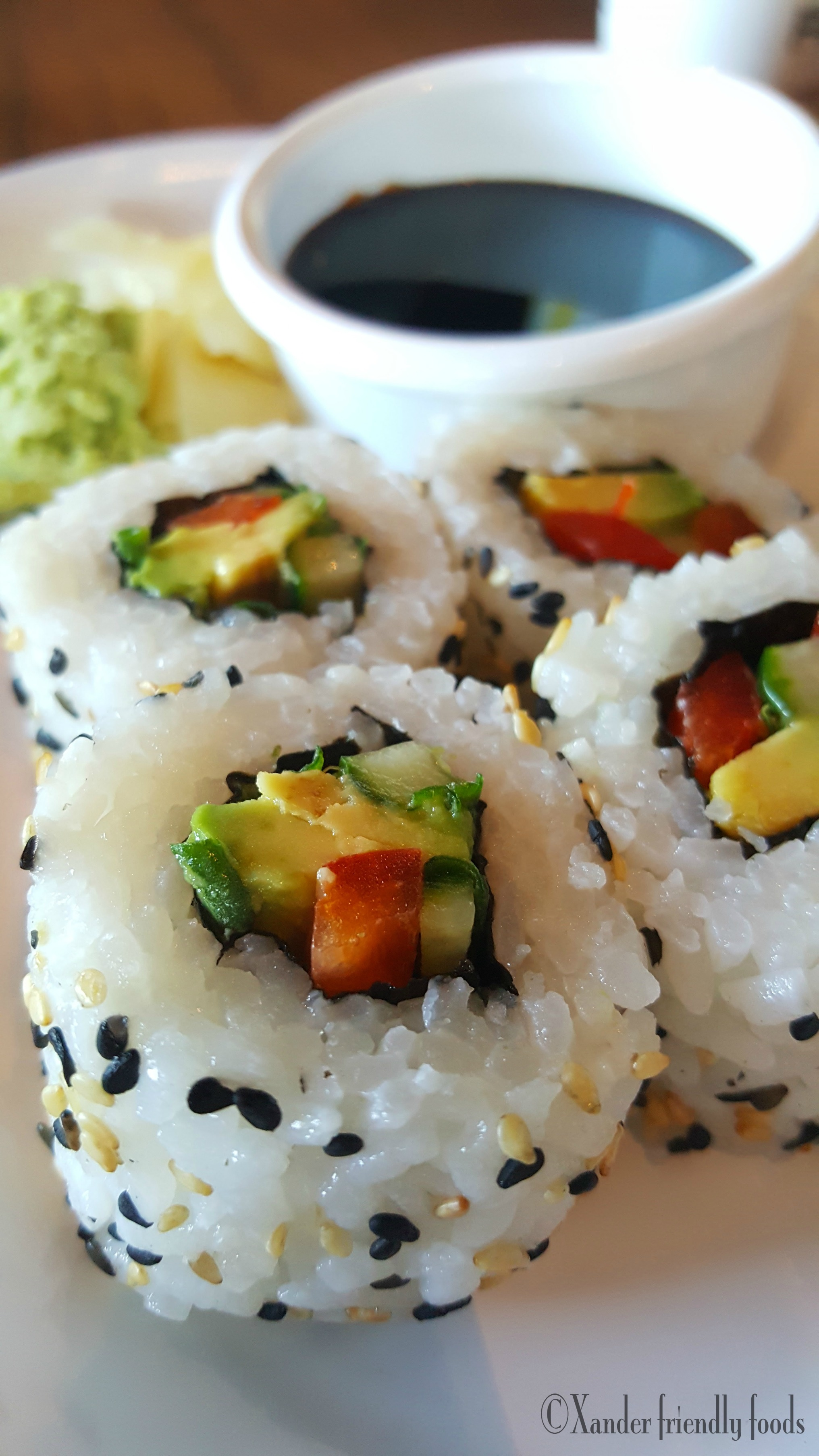 Fresh made, Cucumber Avocado Rolls with sweet red bell peppers and bits of scallions.