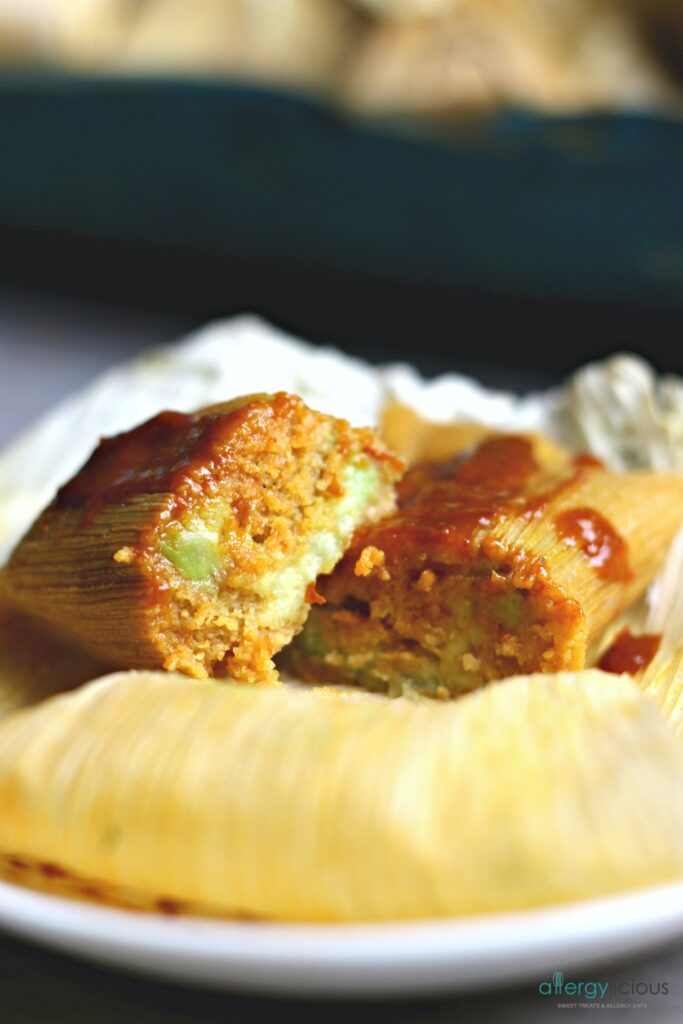 Delicious Red Chile Tamales layered with rich & creamy sliced avocado