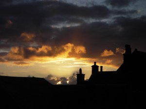 The roof of Ensay House in a nice evening Sky