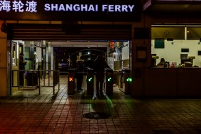 Day Twenty-seven: A couple rush to make the ferry to the Puxi side of the Huangpu River. Normally, the 7:30 pm ferry would be more crowded, but the upcoming Spring Festival has meant fewer people on the ferries and subways.