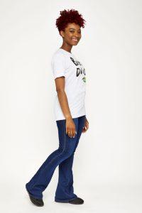 Female model in white shirt side shot