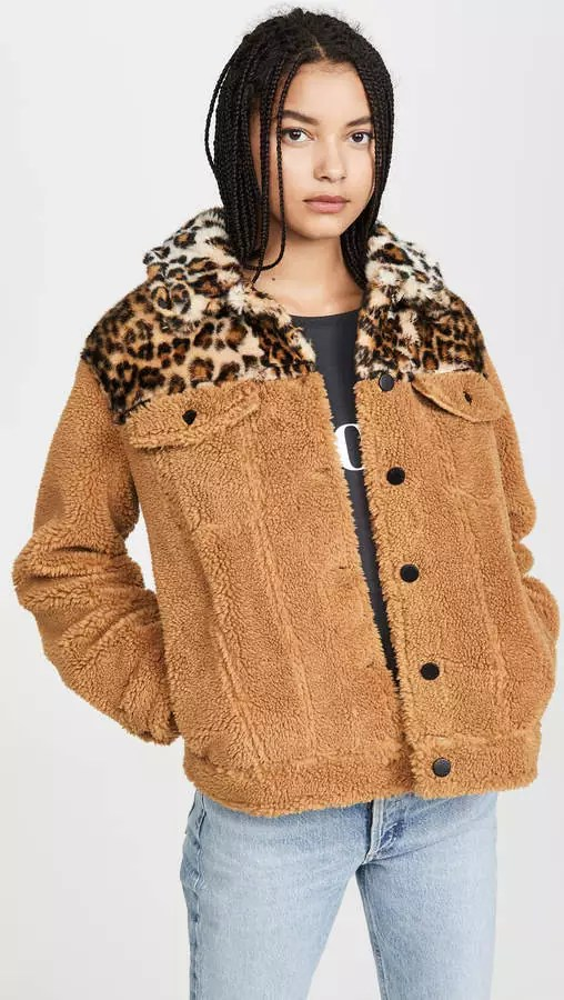 A model wearing a leopard print sherpa jacket from ShopBop.