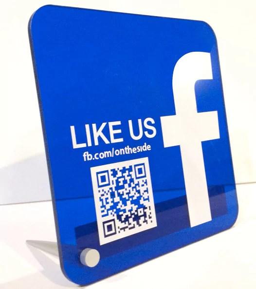 """Aufsteller mit der """"Like us"""" auf Facebook aufschrift"""