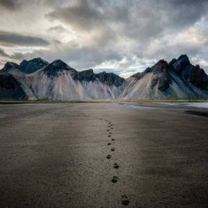 329438 nature landscape mountain clouds Iceland footprints beach sand sea coast snowy peak 748x421 - How Baby Steps Can Lead to Life Changes