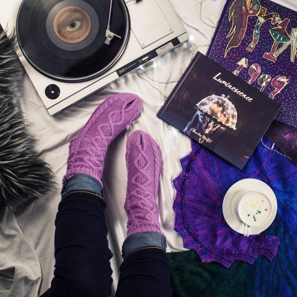woman's purple socks near turntable